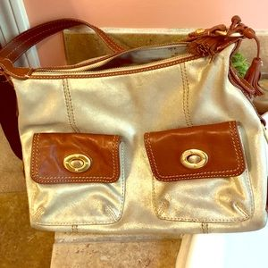 The Sak hobo style purse. Metallic gold color!
